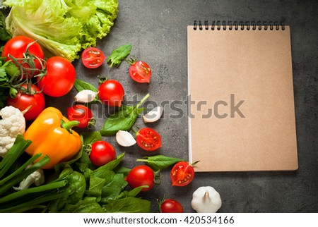 Organic fresh vegetables at slate background with space for text. Healthy eating and Diet concept.