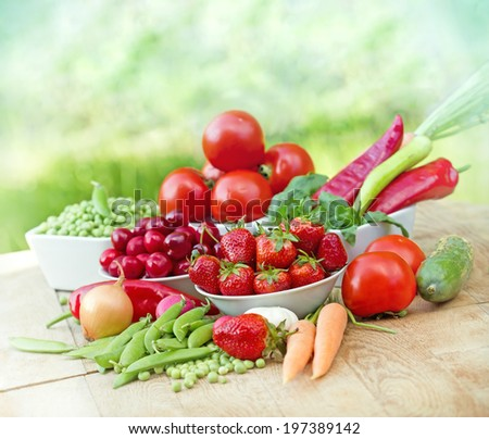 Organic fruits and vegetables on a table - stock photo