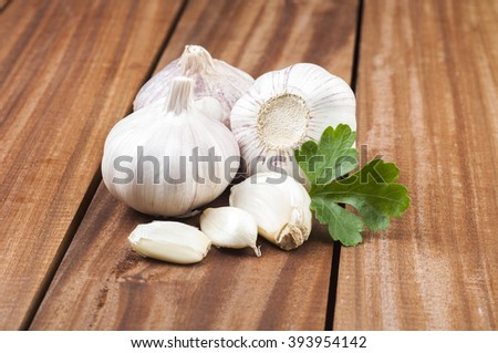Organic garlic whole and cloves on the wooden background - stock photo