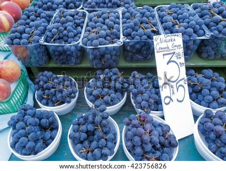 organic grapes on display at outdoor farmers market - stock photo