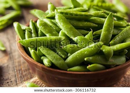 Organic Green Sugar Snap Peas Ready to Eat - stock photo