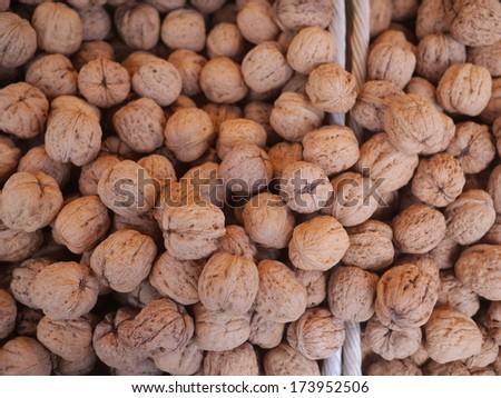 organic grown walnuts at a farmers market - stock photo