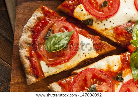 Organic Homemade Margarita Pizza with Basil and Mozarella - stock photo