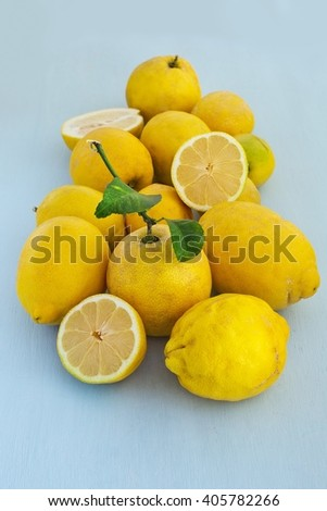Organic lemons fruits on a blue wooden background . Healthy vegetarian food.