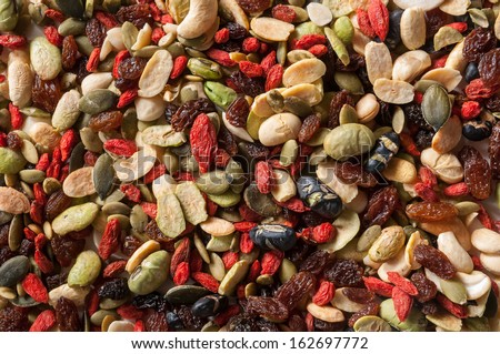 Organic mixed nuts on a white background - stock photo