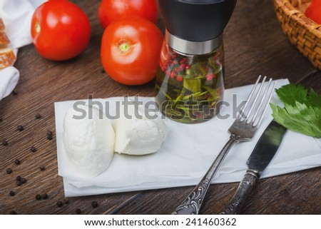 Organic Mozzarella Cheese with Tomato and Basil with decor on the wooden table - stock photo