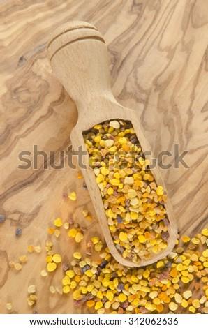 organic pollen on a wooden shovel - stock photo