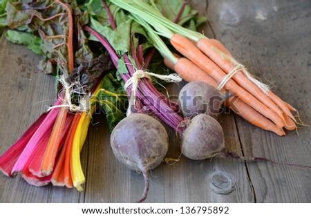 Organic Produce on Rustic Wood - stock photo