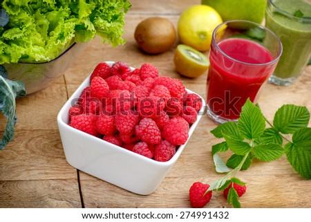 Organic raspberry, smoothie of raspberry and green smoothie (raspberry juice) - stock photo