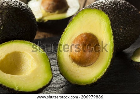 Organic Raw Green Avocados Sliced in Half