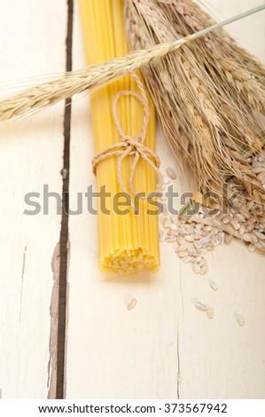 organic Raw italian pasta and durum wheat grains crop  - stock photo