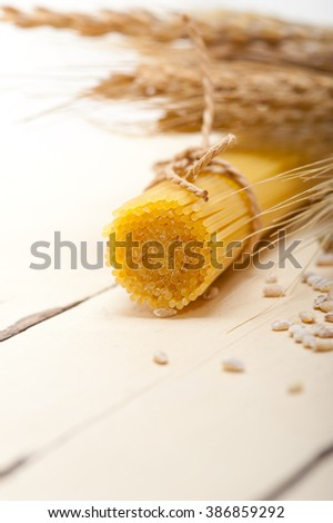 organic Raw italian pasta and durum wheat grains crop  - stock photo