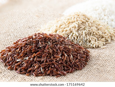 Organic raw rice. Wild rice, brown rice and white rice - stock photo