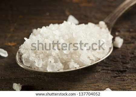 Organic Raw White Sea Salt against a background