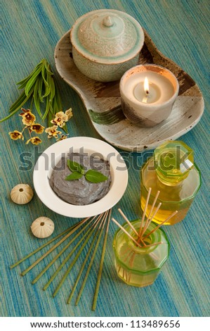 Organic scrub and oil treatment equipment in relaxing spa setting. - stock photo