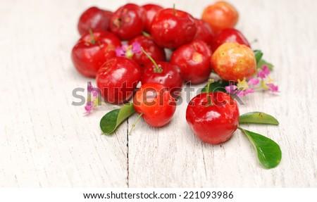 Organic Small red fruit . Brazilian Acerola Fruit . small cherry  - stock photo