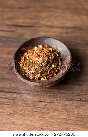 Organic spicy red pepper flakes used for cooking, selective focus - stock photo