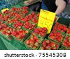 organic strawberries for sale at outdoor farmers market - stock photo