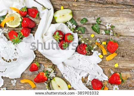 Organic strawberry on rustic background - stock photo
