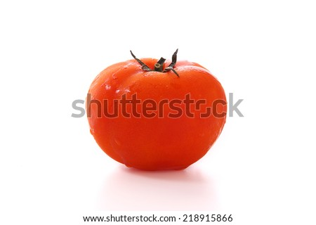 Organic Tomato with side studio lighting isolated on white background - stock photo