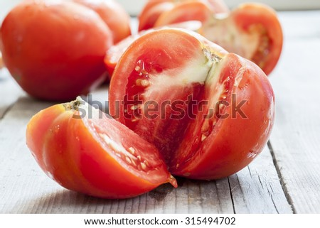 organic tomatoes on wooden board - stock photo