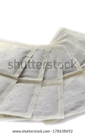 organic unbleached teabags on a white background - stock photo