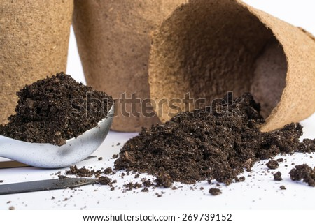 organic vases and dirt on white background. - stock photo