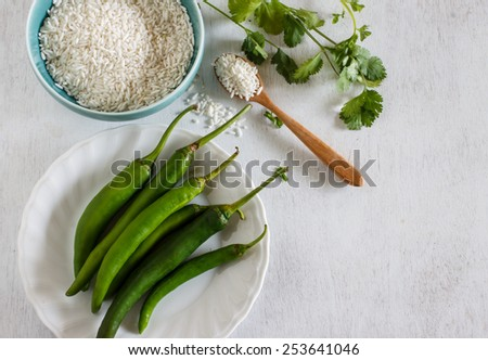 Organic vegetable fresh from garden ingredient for cook, Green chili , jasmine rice with Coriander and yellow scissor - stock photo