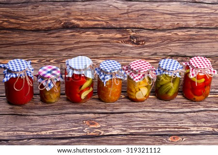 Organic vegetables and fruits. Organic vegetables in glass jars. - stock photo