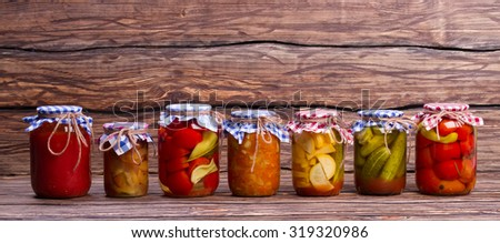 Organic vegetables and fruits. Vegetables in glass jars. - stock photo