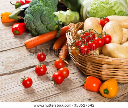 Organic vegetables on old wooden background