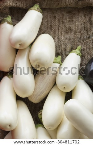 Organic white eggplant in a basket at the farmers market