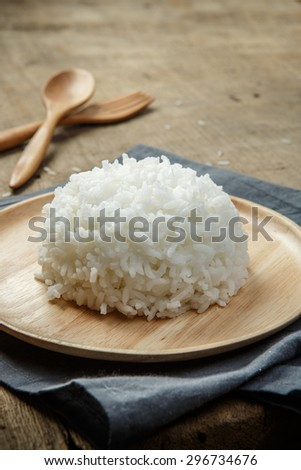 Organic White Rice with wooden spoon & fork - soft focus