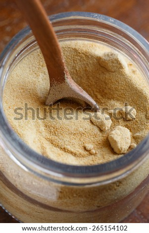 Organic Whole Cane Sugar in a glass jar - stock photo