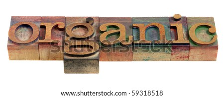 organic word - vintage wooden letterpress printing blocks stained by color inks