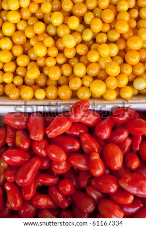 organic yellow and red tomatoes in boxes - stock photo