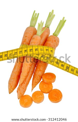 organically grown carrots with tape measure. fresh vegetables and fruits is always healthy. symbolic photo for healthy diet. - stock photo