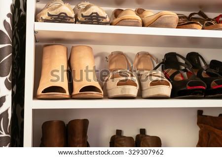 organised wardrobe, the shoe storage - stock photo