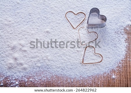 organized copyspace cookies mold in the form of heart on flour and wooden board food and drink concept  - stock photo