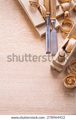 organized copyspace joinery tools old fashioned woodworkers plane chisels planks shawings  - stock photo