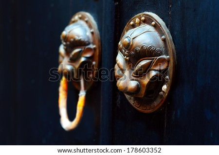 Oriental antique door knocker ancient architecture - stock photo
