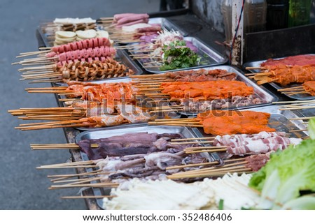 Oriental Asian barbeque sold at night street market in China