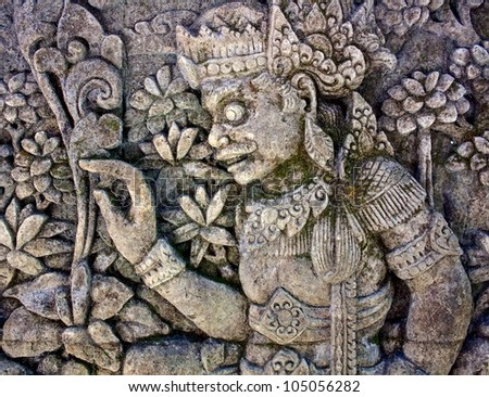 Oriental background. Man surrounded by floral ornament. From a balinese temple - stock photo