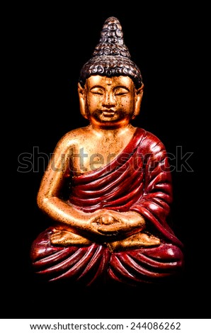 Oriental Buddist Statue Isolated on a Black Background - stock photo