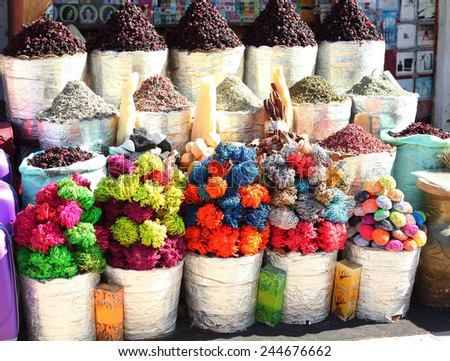 oriental colored goods in open air market in egypt - stock photo