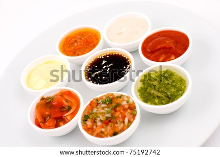 oriental cuisine - several sauceboats with different sauces and seasonings - stock photo