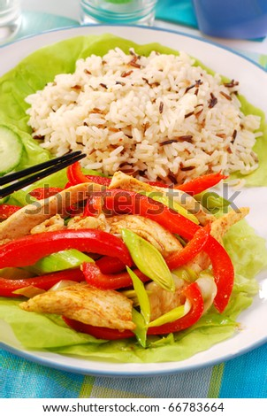oriental deep fried chicken with vegetables and wild rice - stock photo