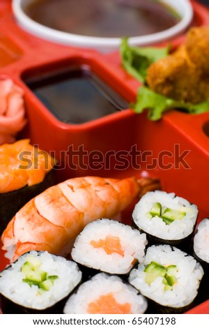 oriental different dishes on a traditional sectioned plate, macro - stock photo