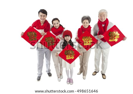 "Oriental family happy New Year, holding red paper on which writing ""blessing"" in Chinese character"
