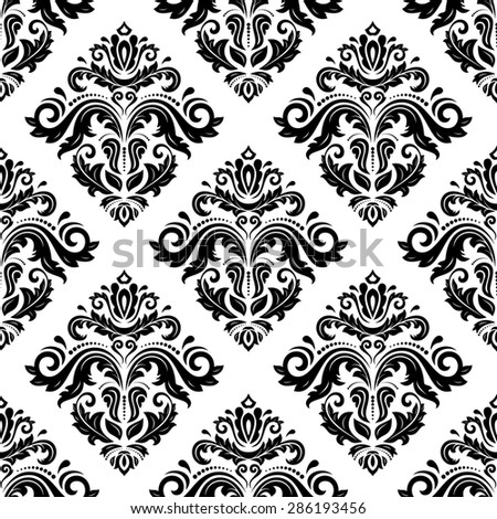 Oriental  fine pattern with damask, arabesque and floral elements. Seamless abstract background. Black and white colors - stock photo